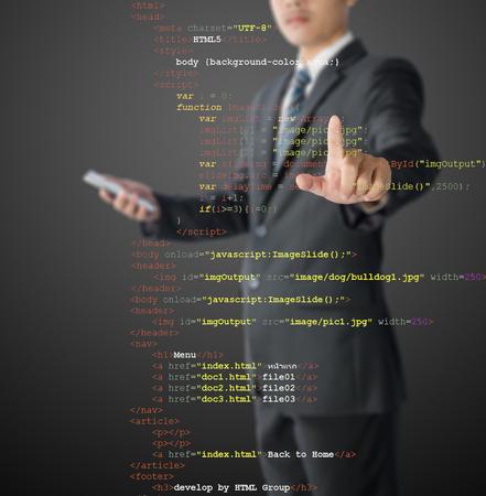 java script: website development - programmer writing HTML and Java Script code Stock Photo