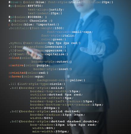 meta data: programmer writing CSS code Stock Photo