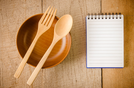blank note book: Blank note book with wooden spoon on tabletop