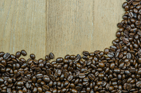 coffeetree: roasted coffee beans on old wood background