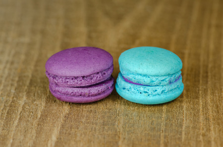 macaroon: the different kinds of macaroon placed on a wooden table