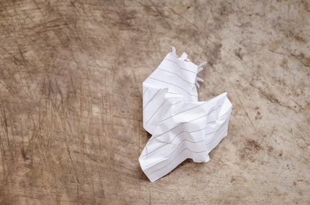 the crumpled note paper on wood background