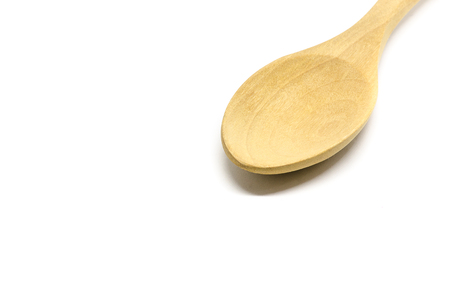 the Wooden spoon isolated on white background