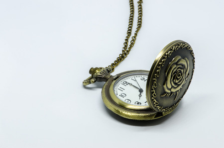Vintage pocket watch on white background
