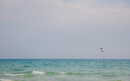 flag in the sea to symbolize for a fishermans boat.