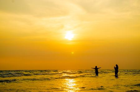 happy people enjoy summer vacation on the beach Stock Photo