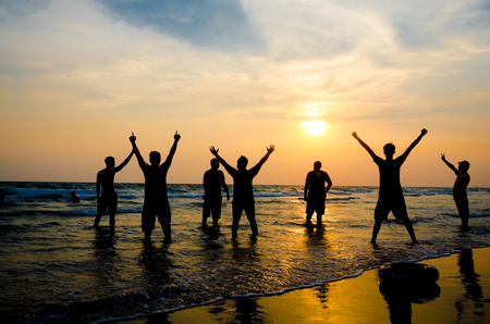 happy peoples enjoy summer vacation on the beach