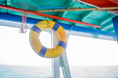 Lifeboats hung in boats for tourists. Stock Photo