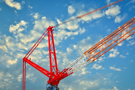 mobile crane: Heavy mobile crane lifting large object. Stock Photo