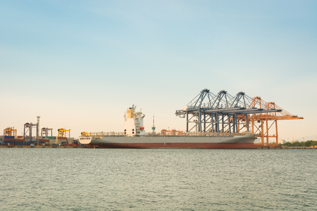 angled view: Motionlessly of cargo ship terminal. Stock Photo