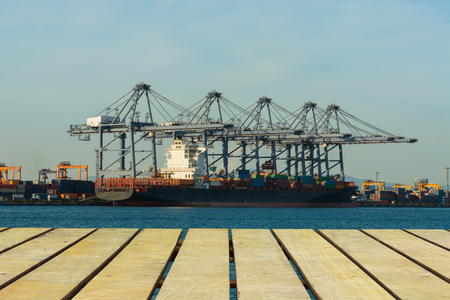 angled view: Unloading container of cargo ship port.