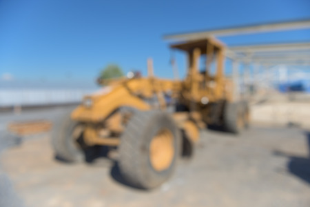 grader: Heavy grader on construction field, Blur scene.