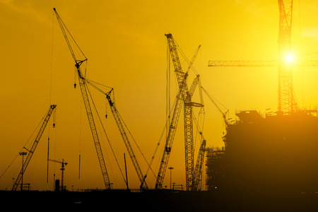 fabrication: Platform oil rig fabrication site, Silhouette of construction activities.