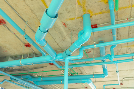 Solid waste & sanitary PVC pipeline suspension. Imagens