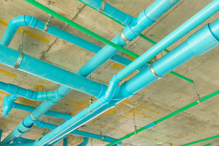 Solid waste & sanitary PVC pipeline suspension. 스톡 콘텐츠
