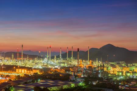 luminosity: Twilight of oil refinery plant, Oil refinery with twilight skies, Luminosity of oil refinery plant, Landscape of oil refinery plant.