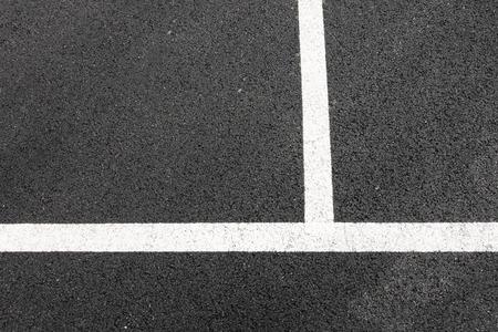 Perpendicular lines on asphalt background.