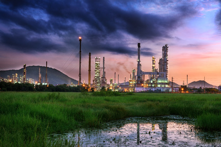 Twilight of oil refinery plant, Oil plant at morning scene on cloudy background.