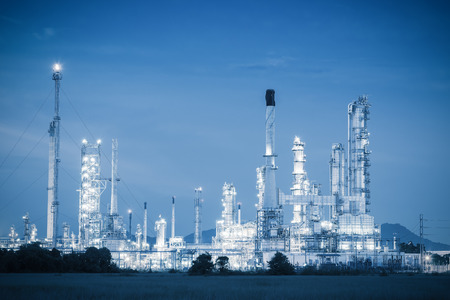 Twilight of oil and gas refinery plant, Blue tone.