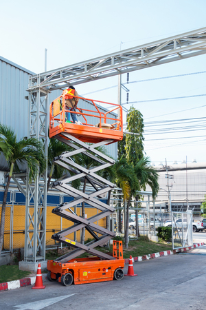 hydraulic lift: Scissor lift platform and electrical technician operated wiring.