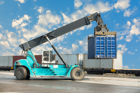 Container unloading truck in logistics yard.