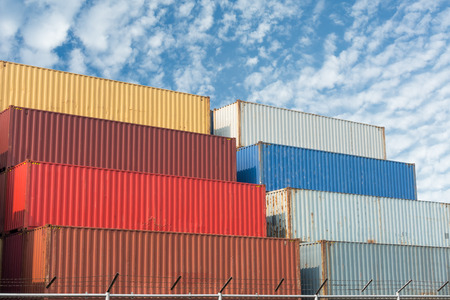 commerce and industry: Handling stack of container shipping with sunshine., Transportation business.