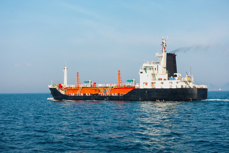 unloading: Shipping and transportation liquid gas over the ocean. Stock Photo