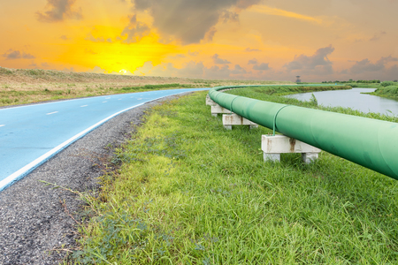Raw water pipeline and distribution parallel of the road. Stock Photo