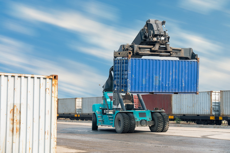 Container lifting truck in the storage yard. Stock Photo