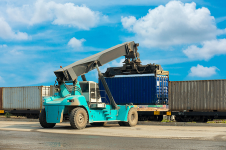 Loading truck at the container logistic yard., Forklift truck.