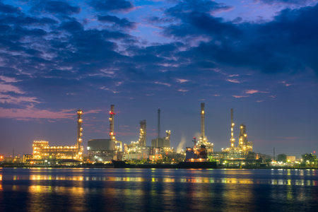 Oil refinery plant and shipping at twilight