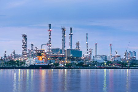 Oil and Gas plant with shipping loading dock at twilight