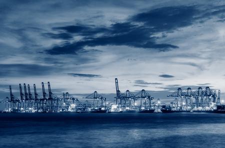 unloading: Cargo ship terminal at twilight