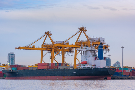 Terminal containers loading and shipping yard at morning scene. Stock Photo