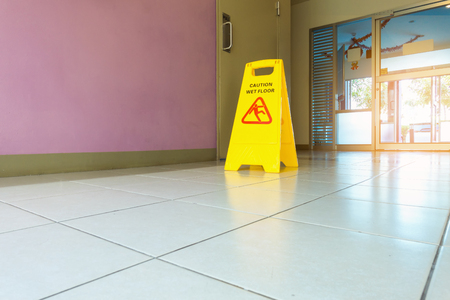 Caution wet flooring signboard and cleaning 写真素材