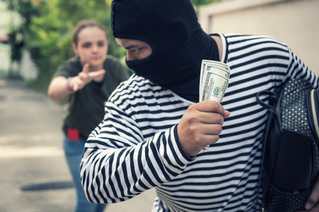 Street thief stealing money from back pocket of jeans woman., Robber, Thief concept