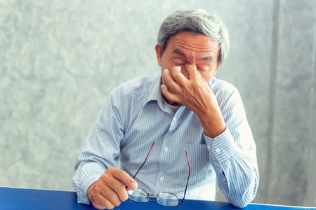 Portrait of senior man is headache and having pain his sinus. Healthcare concept Stockfoto