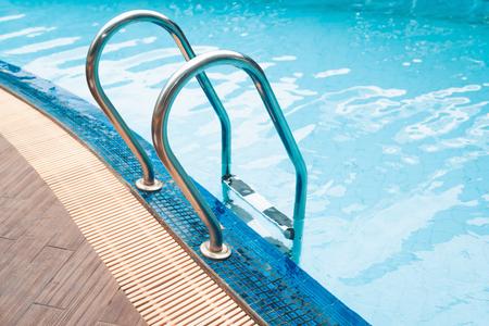 Swimming pool and grab bar ladder