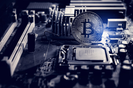 Golden Bitcoin Cryptocurrency on Computer Electronic Mainboard. ,Technology Blockchain and Currency Stock Exchange for Business Financial banking. Market Digital Trading. Imagens