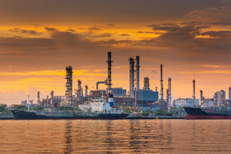 Landscape of Oil and Gas Refinery Manufacturing Plant., Shipping Dock and Chemical Distillation Process Buildings., Factory of Power and Energy Industrial at Twilight Sunset., Engineering Petroleum.