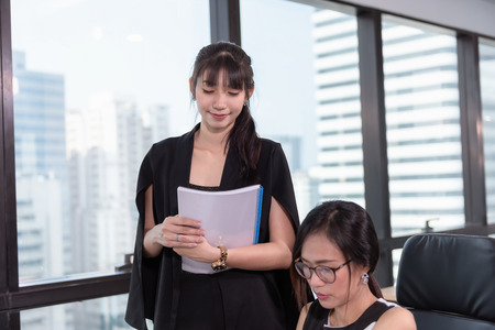 Secretary Assistant Woman is Offering Business Execution of Contract Agreement For Her Manager in Office Workplace. Business Finance and Occupation Concept.