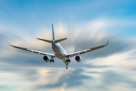An Airplane is Flying in The Clouds Sky on Vacation Journey, International Aviation and Passengers Transportation, Holiday Trip and Traveling Tourist Concept.