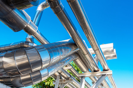 Chiller or Steam Pipeline and Insulation of Manufacturing in Oil and Gas Industrial, Petrochemical Distribution Pipe at Refinery Plant. Overhead Steel Pipe Support and Cooling System. Stock Photo