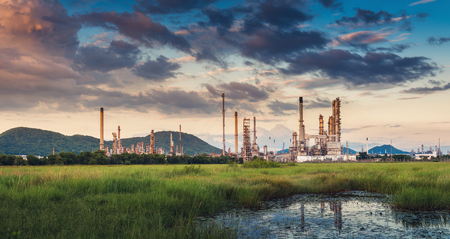 Landscape of Oil and Gas Refinery Manufacturing Plant., Petrochemical or Chemical Distillation Process Buildings., Factory of Power and Energy Industrial at Twilight Sunset, Engineering Petroleum.
