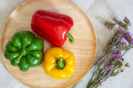 Sweet Peppers of Vegetable Raw Ingredients in a Wooden Dish Ready to Eating., Vegetarian Nutrition Salad and Healthy Cooking Concept.