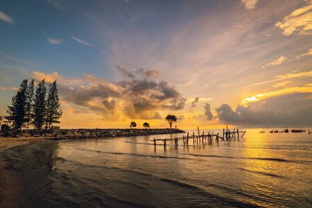 Landscape Sunrise Scenery of Seacoast and Fishing Pier at Fishing Village, South of Thailand, Travel Destination and Vacation Concept.