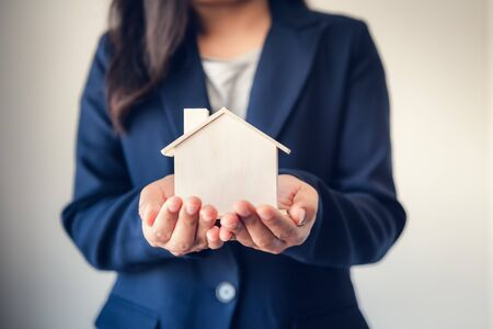 Business Real Estate and Residential Investment Concept, Broker Sell Agency Advisor of Property Estates Handover New Housing to Customers While Holding House Model. Business FinancialInvesting