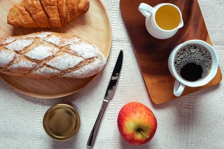 Breakfast Natural Vegetarian Food With Sourdoughs Bread Bakery, Coffee, Honey, Croissant, Apple Fruit on Table., Homemade Fresh Baked French Sourdough for Breakfast. Food NutritionBeverage Concept
