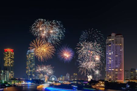 Beautiful of Fireworks Anniversary New Year Celebration With Cityscape Scenery of Bangkok City, Thailand. Amazing Scenic of Colorful Firework Over Chao Phraya River During New Year's Eve Midnight.