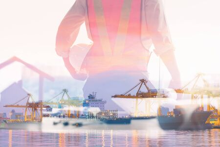 Double Exposure of Engineer in Safety Equipment on Shipping Terminal Industry Background, Technician Man Operator of Handling Container Shipment Freight. Business Transportation and Logistics Industry 写真素材
